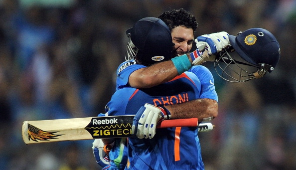 Indian cricketer Yuvraj Singh (R) and captain Mahendra Singh Dhoni celebrate after beating Sri Lanka during the ICC Cricket World Cup 2011 final match at The Wankhede Stadium in Mumbai on April 2, 2011.  India defeated Sri Lanka by six wickets to win the 2011 World Cup.       AFP PHOTO/MANAN VATSYAYANA (Photo credit should read MANAN VATSYAYANA/AFP/Getty Images)