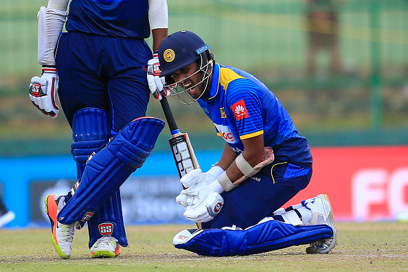 Sri Lankan cricketer Dinesh Chandimal reacts after the ball hit on his wrist during the 3rd One Day International cricket match between Sri Lanka and India at the Pallekele international cricket stadium at Kandy, Sri Lanka on Sunday 27 August 2017. (Photo by Tharaka Basnayaka/NurPhoto via Getty Images)