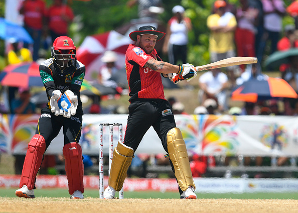Florida , United States - 31 July 2016; Brendon McCullum (R) of Trinbago Knight Riders hits 4, watched by Devon Thomas (L) of St. Kitts & Nevis Patriots during Match 29 of the Hero Caribbean Premier League match between Trinbago Knight Riders and St Kitts and Nevis Patriots at Central Broward Stadium in Lauderhill, Florida, United States of America. (Photo By Randy Brooks/Sportsfile via Getty Images)