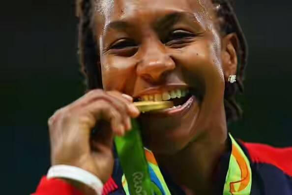 592329944-gold-medalist-tamika-catchings-of-united-gettyimages-1471859891-800 1