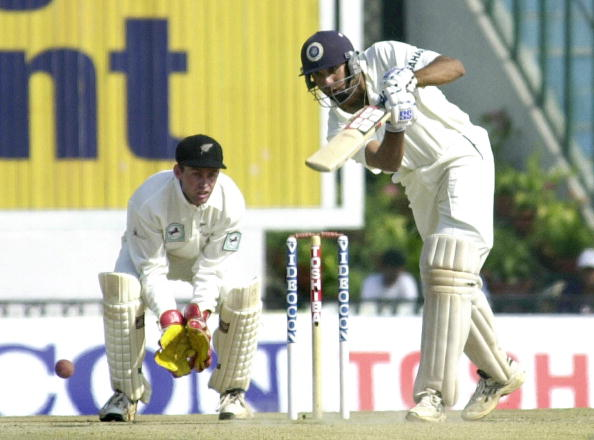 Indian player V.V.S. Laxman (R) watches