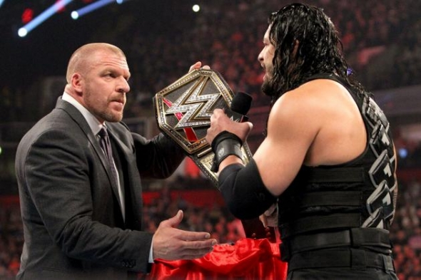 roman-reigns-triple-h-wwe-title-e1452798237986